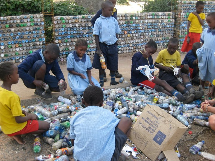 Children giving a helping hand in making Eco-blocks for the construction of a heavy-duty perimeter wall at Uhuru Primary School. - Copy